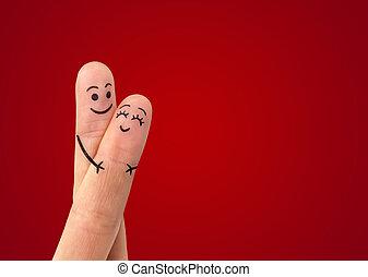 a, couple heureux, amoureux, à, peint, smiley, et, étreindre