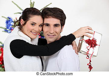 a couple hugging at Christmas time