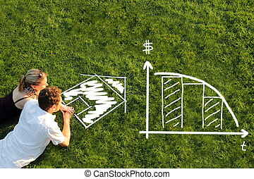 Couple in a meadow planning mortage for a house
