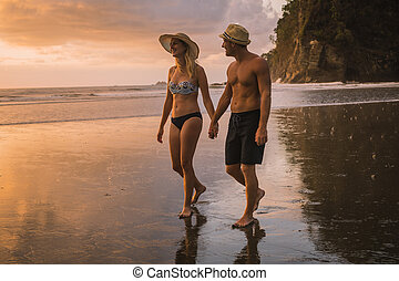 Couple in love having romantic tender moments at sunset on the beach