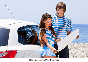 A couple is going on a car trip - A happy couple is going on...