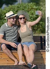 a couple is taking selfie