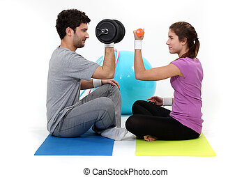 A couple lifting weights.