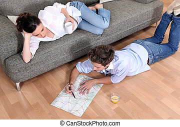 a couple looking a map at home