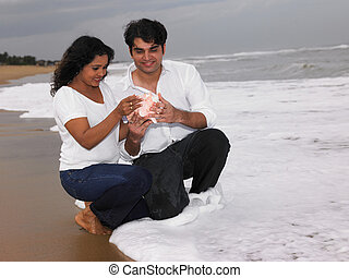 a couple looking at a conch