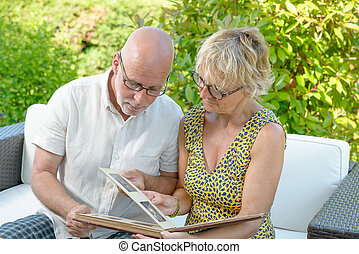 a couple looking at a photo album