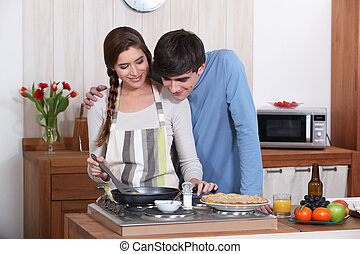 A couple making crepes.