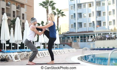 couple near the pool, couple yoga&