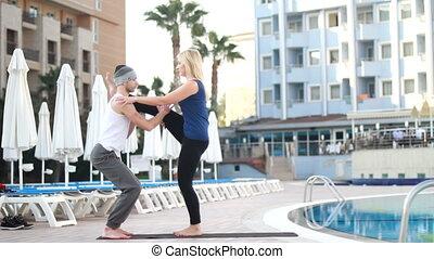 couple near the pool, couple yoga&