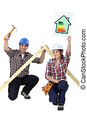 A couple of carpenters promoting energy savings.