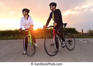 a couple of cyclists stopped on the road