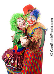 A couple of smiling clowns dancing. Isolated