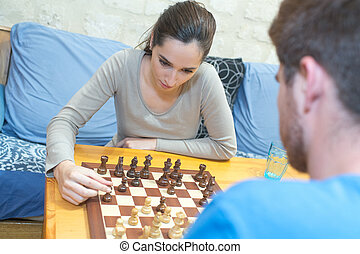 a couple of teenagers playing chess