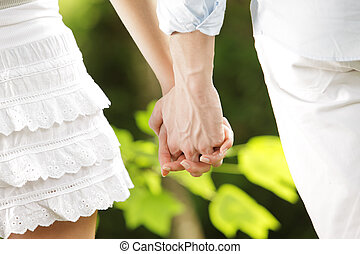 holding hands in a park