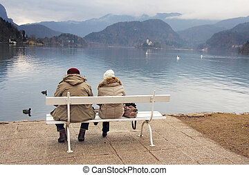 A couple on a bench