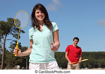 A couple playing badminton