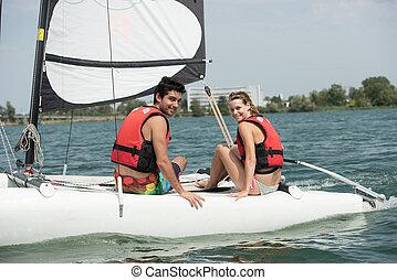 a couple sailing on the lake