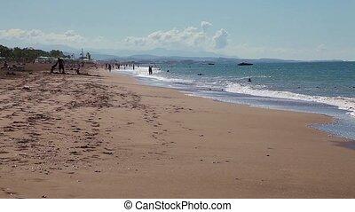 A couple walking along the seashore