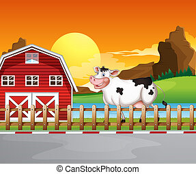 A cow beside the wooden barnhouse