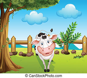 A cow inside the fence