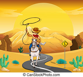 A cowboy riding on a horse travelling through the desert