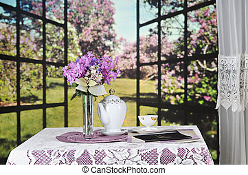 A Cozy Spring Read - A small table set with a lacey ...