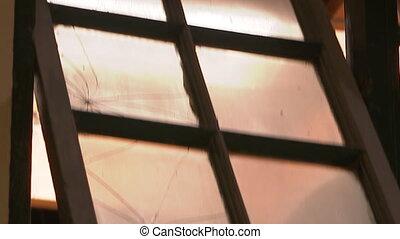 A cracked open window - A tilt down shot of a window that...