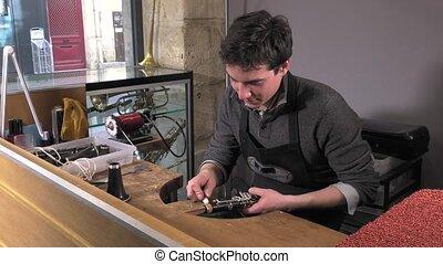 a craftsman repairing a clarinet