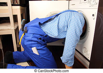 Craftsman repairing washing machine