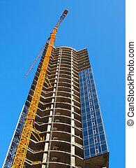 A crane and skyscraper building under construction