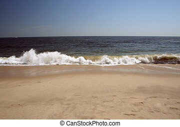 Crashing wave on the beach - A Crashing wave on the beach in...