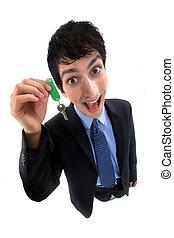A crazy businessman handing a key.