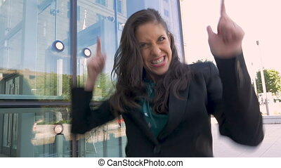 A crazy female business executive doing a victory dance and...
