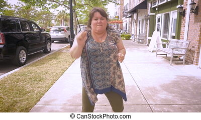 A crazy plus sized woman dancing in the streets celebrating...