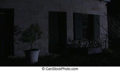 A creepy haunted house - A steady medium shot of a house...