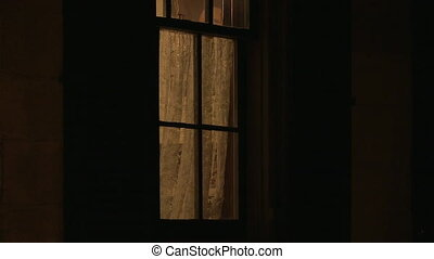 A creepy window of a haunted house - A steady shot of a...