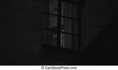 A creepy window of a haunted house - A steady zoomed in...