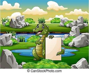 A crocodile holding blank sign near the small pond