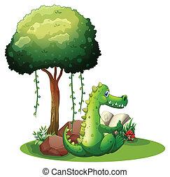 A crocodile reading beside the tree