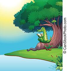 A crocodile reading under the tree