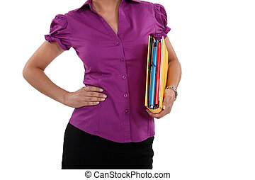 A cropped picture of a businesswoman with a folder.