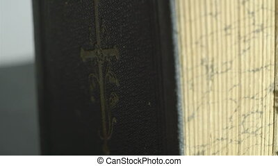 A cross image in front of the bible