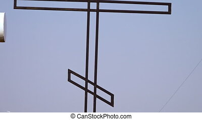 A cross in a cemetery - A moving shot of a cross in a...