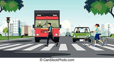 A crosswalk in the city - People walking on a crosswalk with...