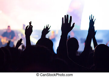 crowd - A crowd level view of hands raised from the...