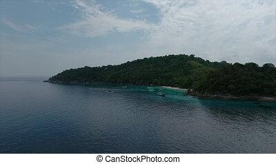 A cruise ship on a blue sea - A medium shot of a cruise ship...