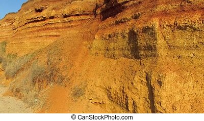 A crumbling brown texture rock - the camera slowly rises to...