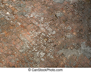 A crumbling old road paved by a square stone in orange .Texture or background.