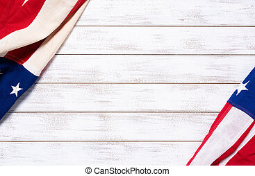 A crumpled American flag on a white plank background with copy space for holidays etc.