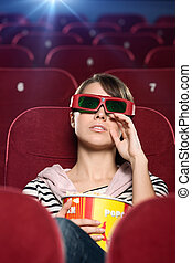 A crying woman in the movie theater